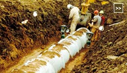 Image of Pipe Installation Construction Site: Laying Pipe